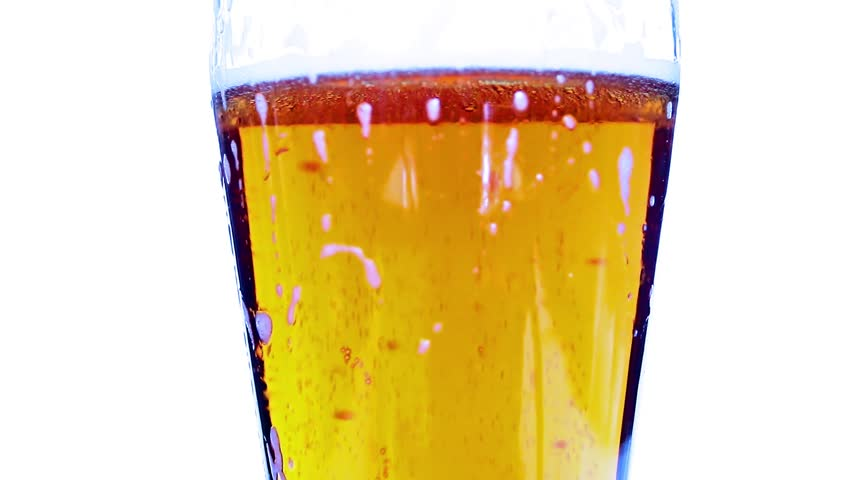 Bubbles of clean air in a glass with a light beer | Shutterstock HD Video #31376116