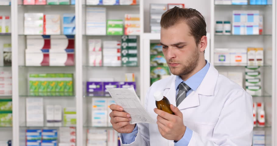 experienced pharmacist man read prescription drug analyzing information pharmacy 4k stock video clip - Drug Information Pharmacist