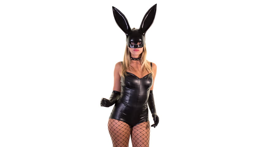 sexy woman dances with large bunny ears mask and black latex body. great clip for disco, party and events