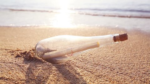 Message in a bottle on sand beach