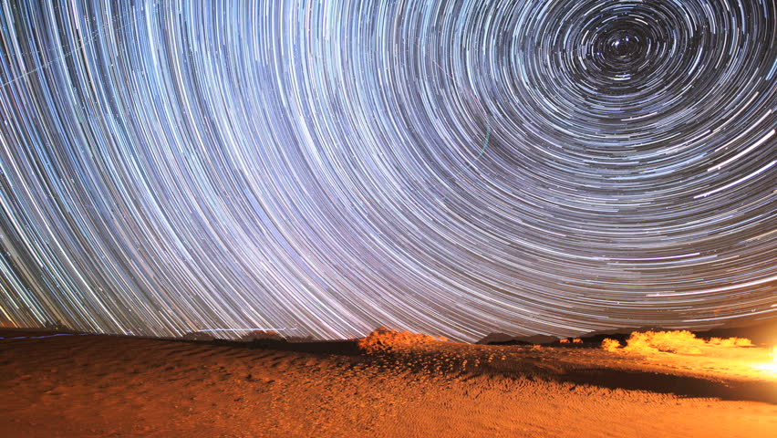 Unbelievable Galaxy Space Star Trails Timelapse Over Desert in Eureka Dunes. Death Valley, California. Shot during the 2012 Geminid Meteor Shower