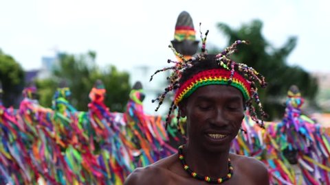 Afro dancing around the a colorful religious brazilian ribbons in Salvador, Bahia, Brazil