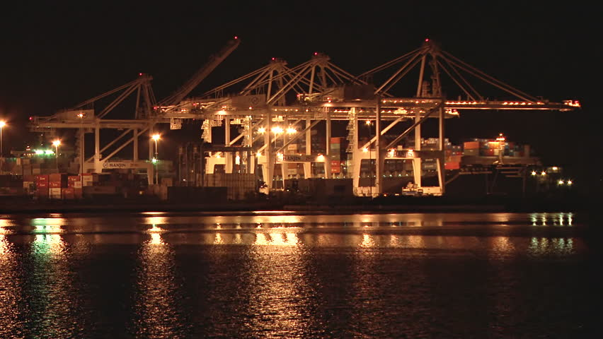 OAKLAND, CA - CIRCA 2012: Port of Oakland at night: Various shots depicting the