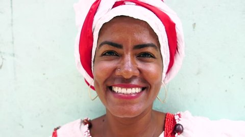Portrait of Brazilian Woman, dressed in traditional Baiana attire in Salvador, Bahia, Brazil