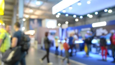 Abstract Defocused Blurred Background flow of many people inside space shopping center or mall, exhibition, exposition, hall real time.