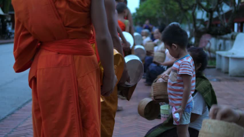 Buddhist Monks Walking On Street At Alms Giving Ceremony. Luang Prabang, Laos, 23 August, 2017. HD, 1920x1080.