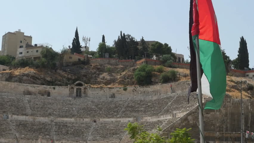 Jordan flag waving in the wind at the colosseum in Amman Close Up #31594999