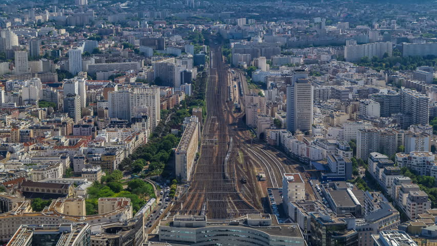 Top view of Paris skyline from above timelapse. Main landmarks of european megapolis with train station of Vaugirard-Belt. Bird-eye view from observation deck of Montparnasse tower. Paris, France | Shutterstock HD Video #31599226
