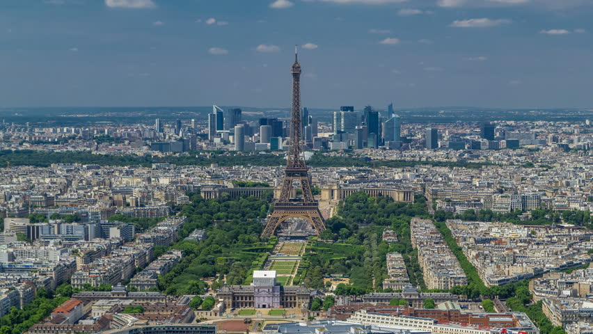 Aerial view from Montparnasse tower with Eiffel tower and La Defense district on background timelapse in Paris, France. Top view from observation deck at sunny summer day. | Shutterstock HD Video #31599286