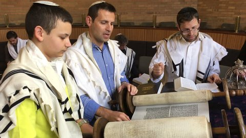 AUCKLAND - OCT 11 2017:Jewish people reading from the Torah Aliyah Blessings during the High Holidays. Reading the Torah is one of the bases for Jewish life.