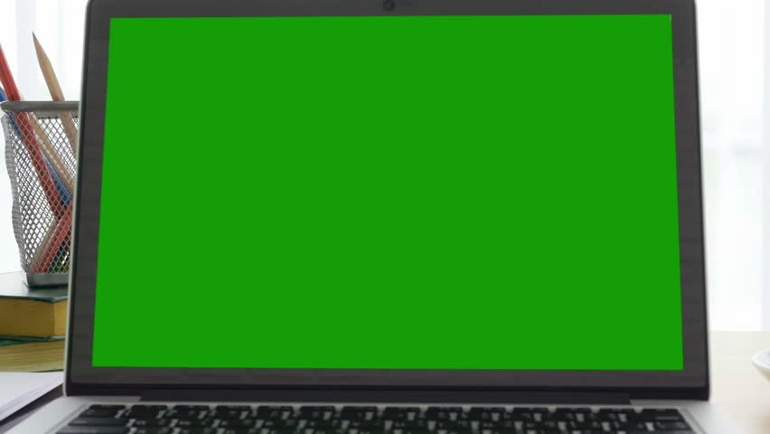 4K : A laptop computer with a key green screen set on work office table. | Shutterstock HD Video #31644226