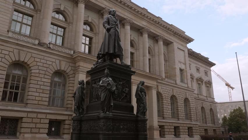 BERLIN - SEPTEMBER 17, 2017: Statue of Minister Baron (Freiherr) vom Stein in front of Abgeordneten Haus (Parliamentary Building) - Camera moves around - 4K