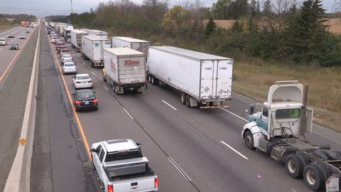 Guelph, Ontario, Canada October 2017 Tractor trailer trucks stuck in epic highway traffic jam and gridlock