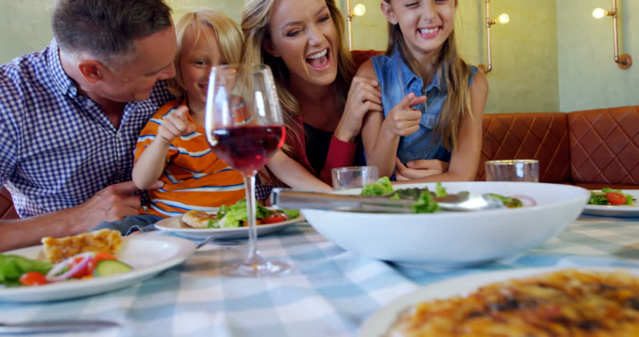 Happy Family Having Meal Together In Restaurant 4k