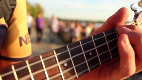 Close up Hand playing ukulele.