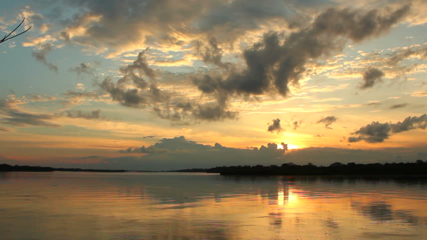 Sunset over a major tributary of the Amazon - the Rio Napo in Ecuador - Timelapse