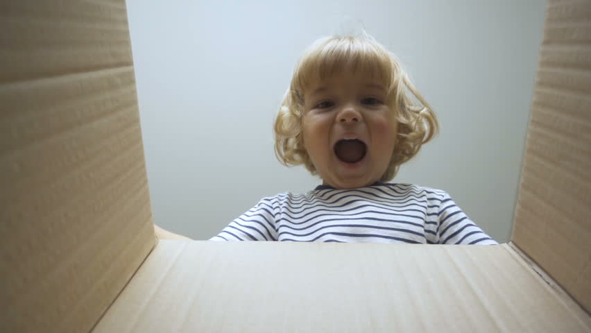 A little boy looks in the box, is surprised and happy to receive a surprise. The child opened a box with a gift. Slow Motion. | Shutterstock HD Video #31789576