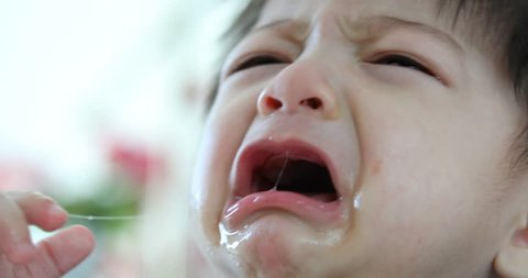 baby boy crying with tears unhappy feeling