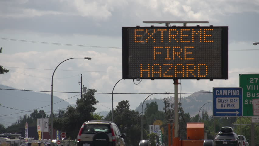 LED Road Sign: Evacuees Follow Signs - Extreme Fire Hazard - Please Use Caution. Along highway during extreme fire season in British Columbia. Vernon, BC. Long Shot | Shutterstock HD Video #31820326
