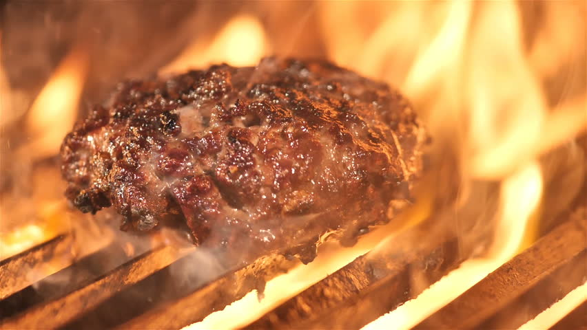 burger meat is grilled