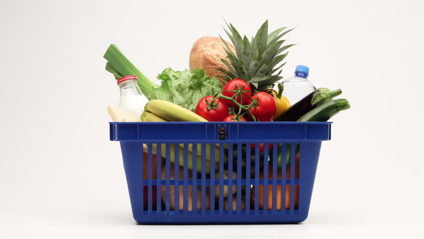Side view on shopping basket filled with vegetables, bread and milk products moving on white background. 4K stop motion animation. | Shutterstock HD Video #31868146