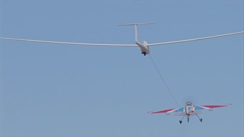 Airplane towing glider for take-off
