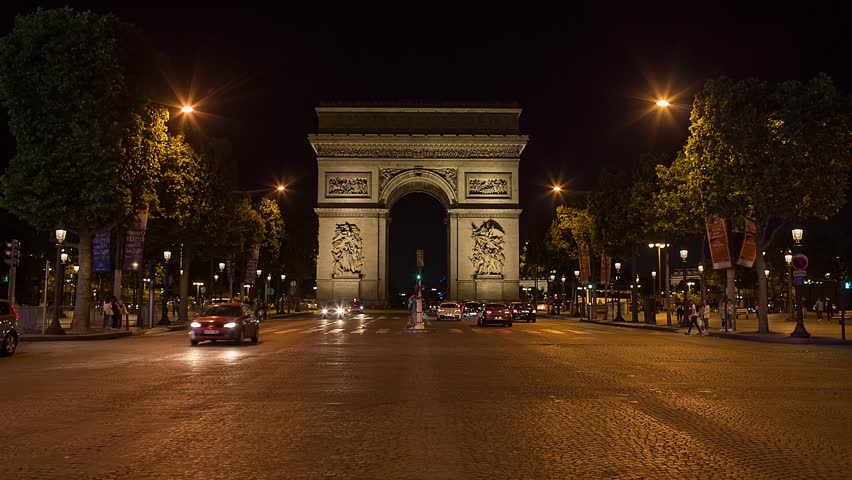 PARIS, FRANCE - JUNE 12, 2017: A trafic on Chaps Elysees at night with triumphal arch on background | Shutterstock HD Video #31909687