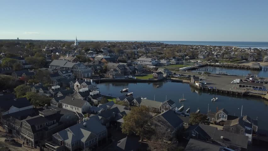 Nantucket Village close AERIAL from water. Nantucket, a tiny, isolated island off Cape Cod, Massachusetts, is a summer destination with dune-backed beaches.