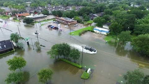 LEAGUE CITY, TEXAS - AUGUST 27th 2017 Military Truck driving through flooded streets during Hurricane Harvey
