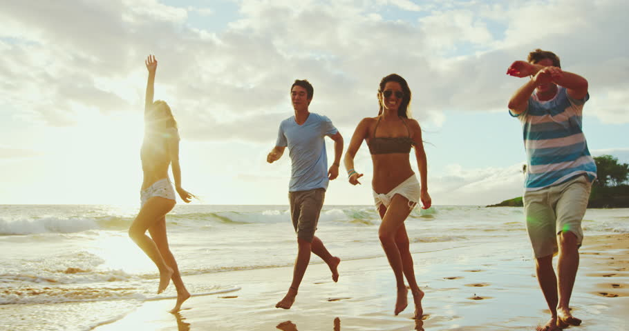 Friends having fun running down the beach at susnet | Shutterstock HD Video #31935886