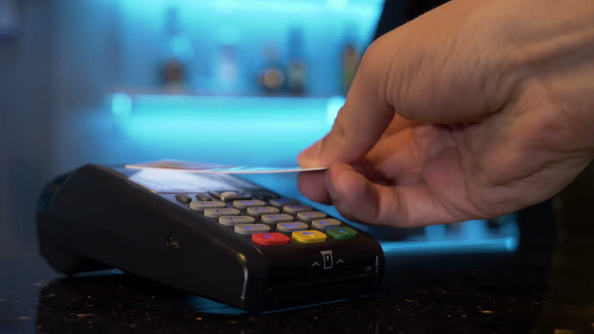 Customer using credit card over pos module for cashless contactless payment for shopping | Shutterstock HD Video #31956046