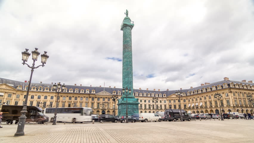 Vendome column with statue of Napoleon Bonaparte on the Place Vendome timelapse hyperlapse. Paris, France. Cloudy sky at summer day and traffic on road