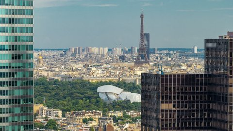 View of Paris and Eiffel Tower timelapse from the top of the skyscrapers in Paris business district La Defense. Sunny summer day. Paris, France