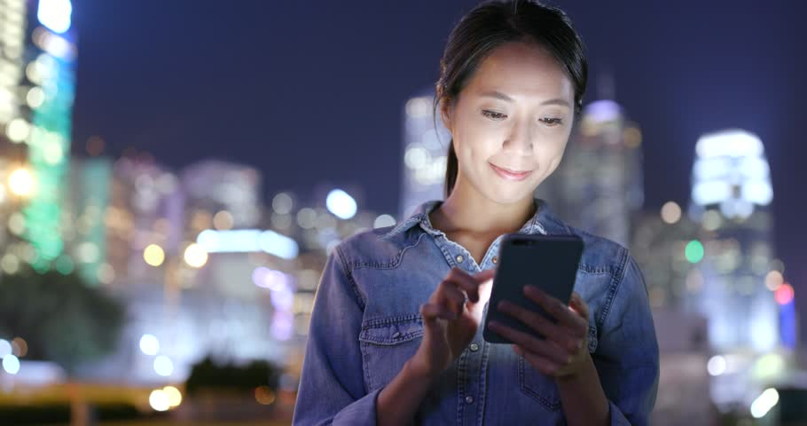 Woman working on mobile phone in the city at night  | Shutterstock HD Video #31973476