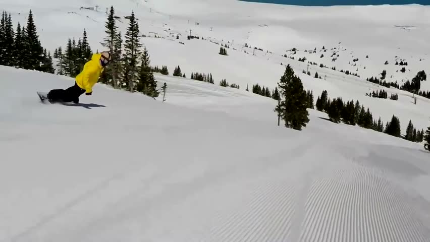 Amazing winter mountain landscape first pov on professional snowboarder gliding downhill spraying snow performing stunts