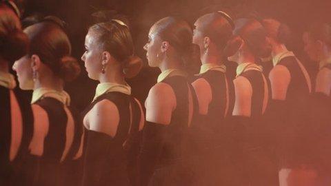 Close up portrait of cabaret dancers on stage
