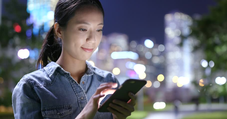Woman looking at mobile phone at night  | Shutterstock HD Video #31994893