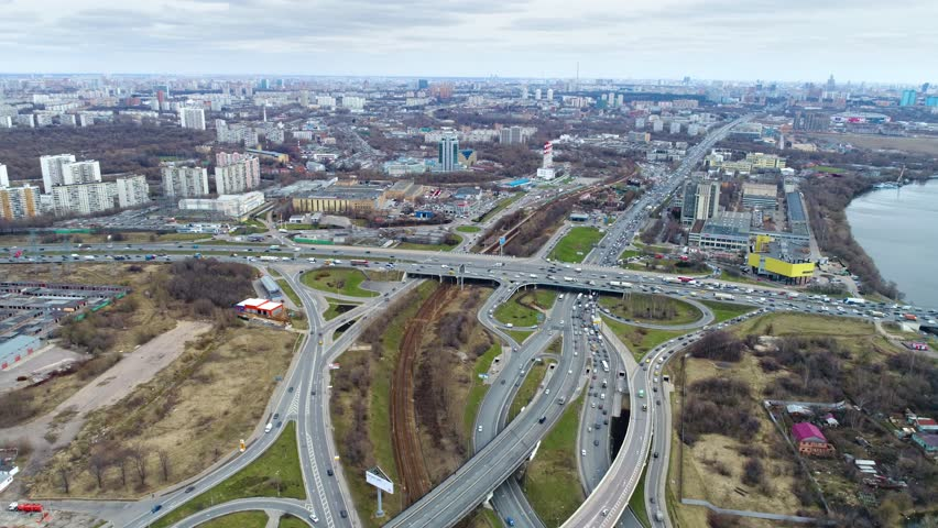 Aerial view of a freeway intersection. Moscow suburb. The view from the bird's flight | Shutterstock HD Video #32000056