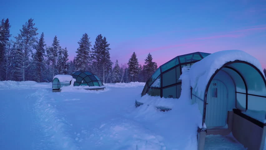 4k00:20LAPLAND, FINLAND   MARCH 2017: Glass Igloo Village At Snowy  Kakslauttanen Arctic Resort, Finland. Igloos For Watching Northern Lights  During The ...