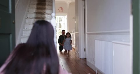 Girl running to welcome Mum home