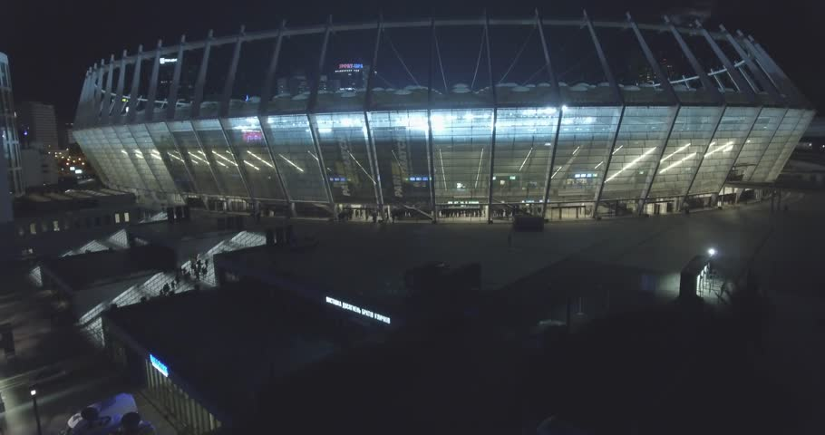 aerial survey. Kiev-Olympic Stadium October 9, 2017. World Cup. Ukraine-Croatia. cityscape time of day night. The view from the top to the illuminated stadium with games and fans.
