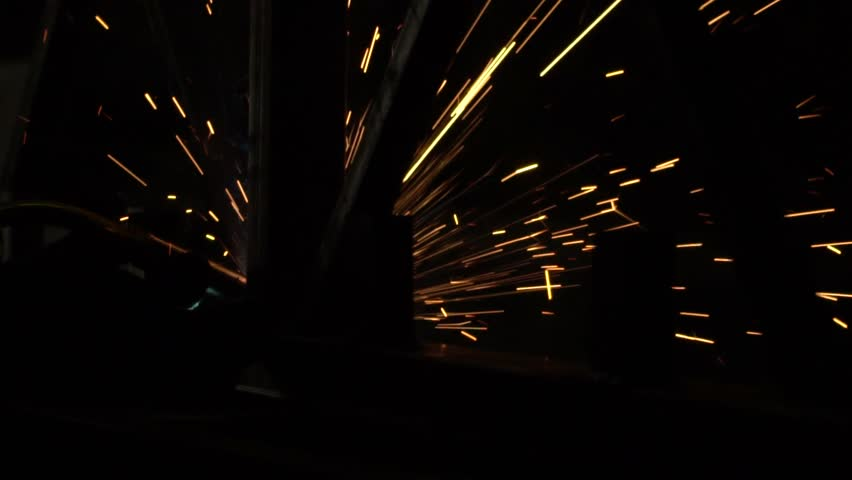 Bright sparks from welding in the dark.  #32036236