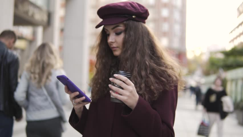 Young woman using phone stand and drink coffee   Shutterstock HD Video #32058796