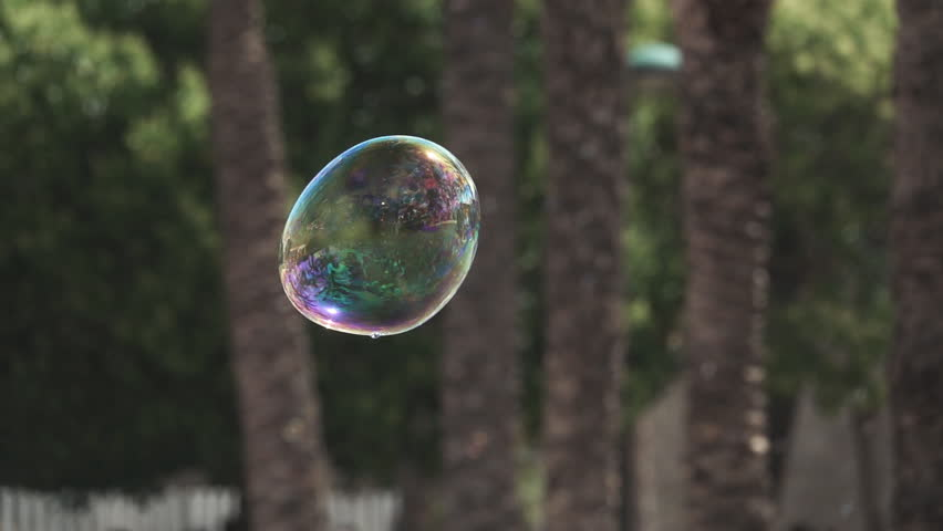 Super slow motion of big soap bubble exploding in the air | Shutterstock HD Video #32061826