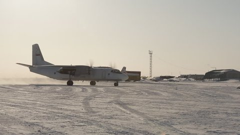 airplane on the runway, the plane is landing, snow-covered runway, small passenger plane,  Russia