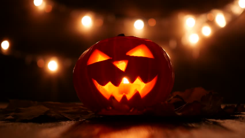 Carved Halloween pumpkin with lights on background. Dark key footage in UltraHd resolution. | Shutterstock HD Video #32098447