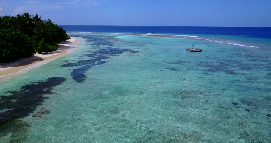 V09827 vacation in maldives tropical islands with view from aerial flying drone on white sand beaches and blue sky and sea   Shutterstock HD Video #32107456