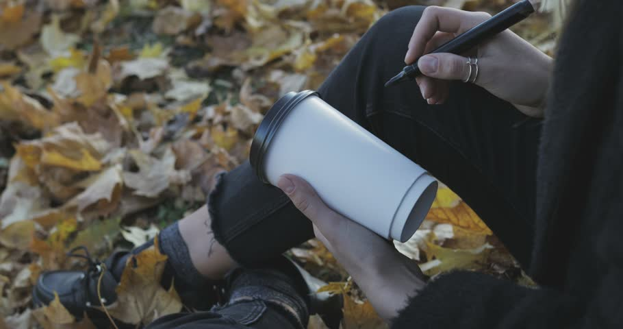 Woman holding Hot drink in paper cup in hand | Shutterstock HD Video #32144713