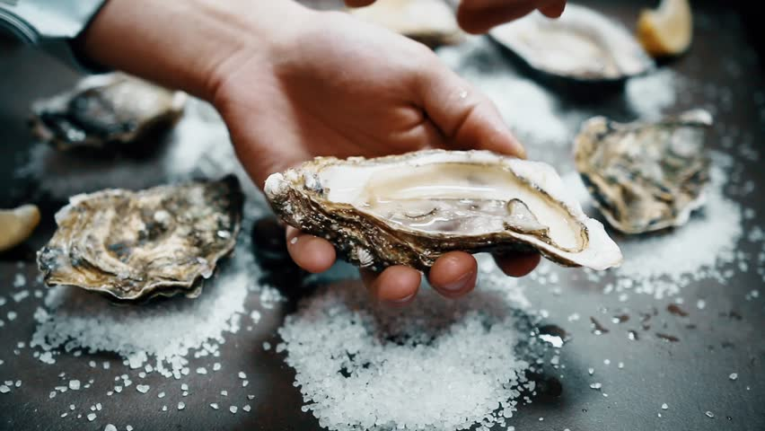 Open oyster with lemon juice | Shutterstock HD Video #32153176