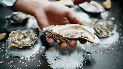 Open oyster with lemon juice